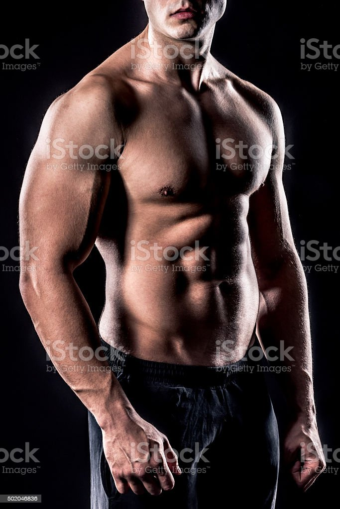 beautiful male torso isolated on black background stock photo