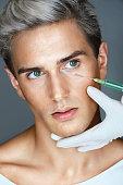 Beautiful man gets beauty facial injections.