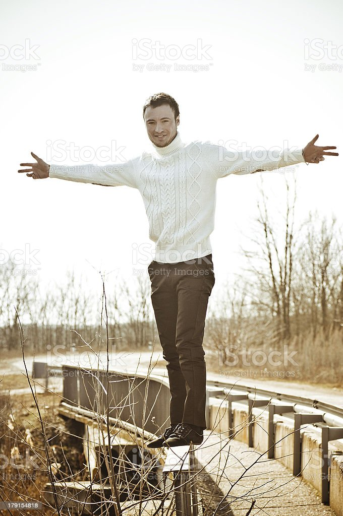 Beautiful man in white sweater royalty-free stock photo