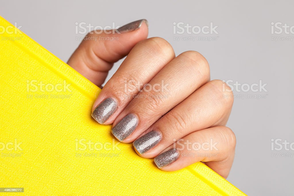 Beautiful manicure on female hand stock photo