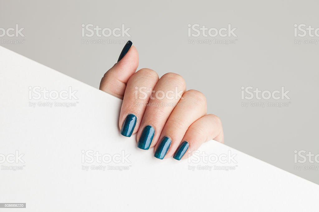 Beautiful manicure on female hand stock photo