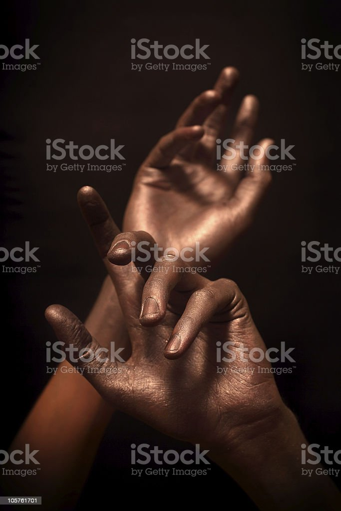 beautiful man's hands in bronze paint royalty-free stock photo