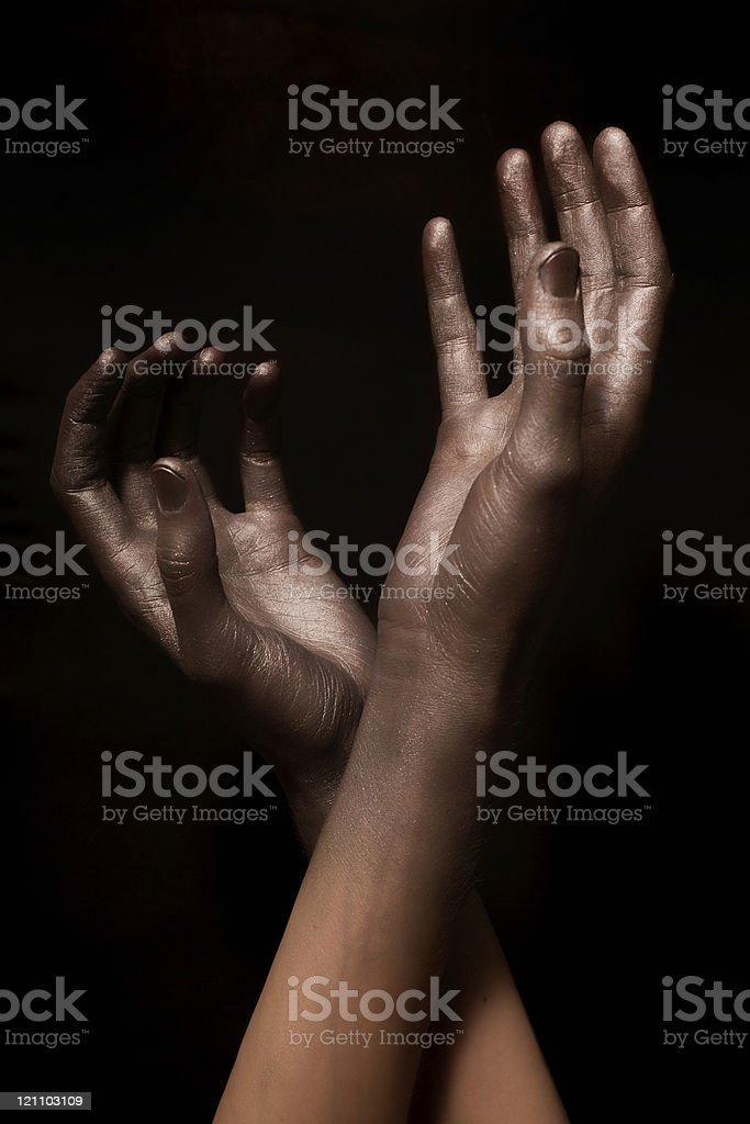 beautiful man's hands in gold paint royalty-free stock photo