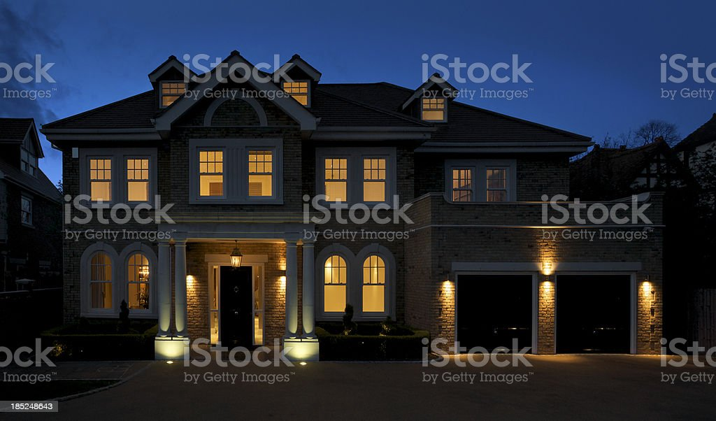 beautiful mansion at dusk stock photo