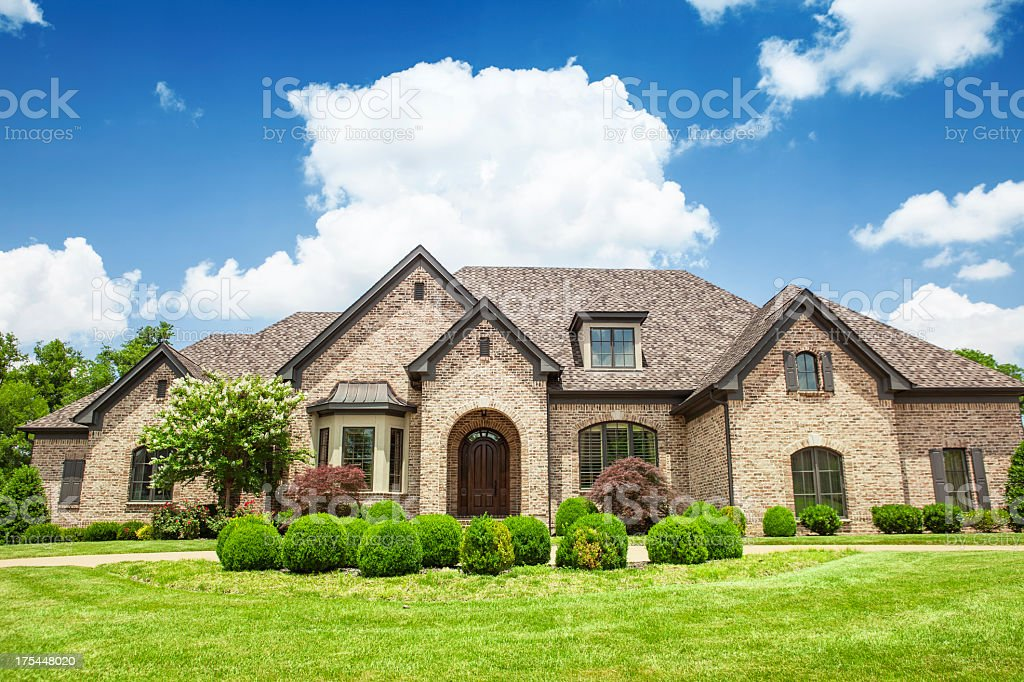 Beautiful mansion with a green yard stock photo