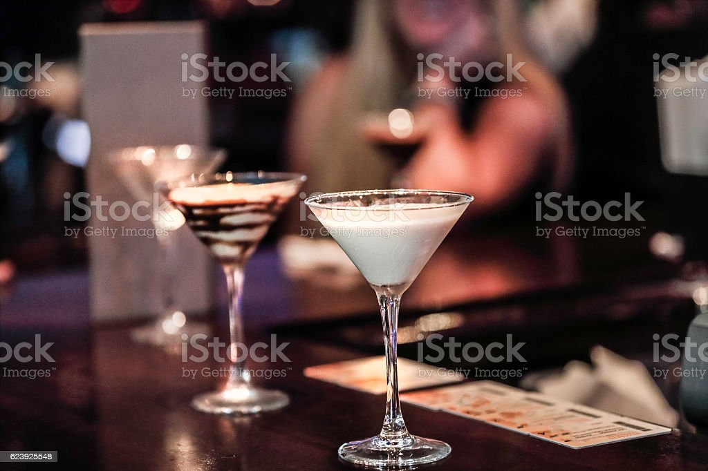 Beautiful Martini Glasses filled with speciality cream liquor drinks stock photo