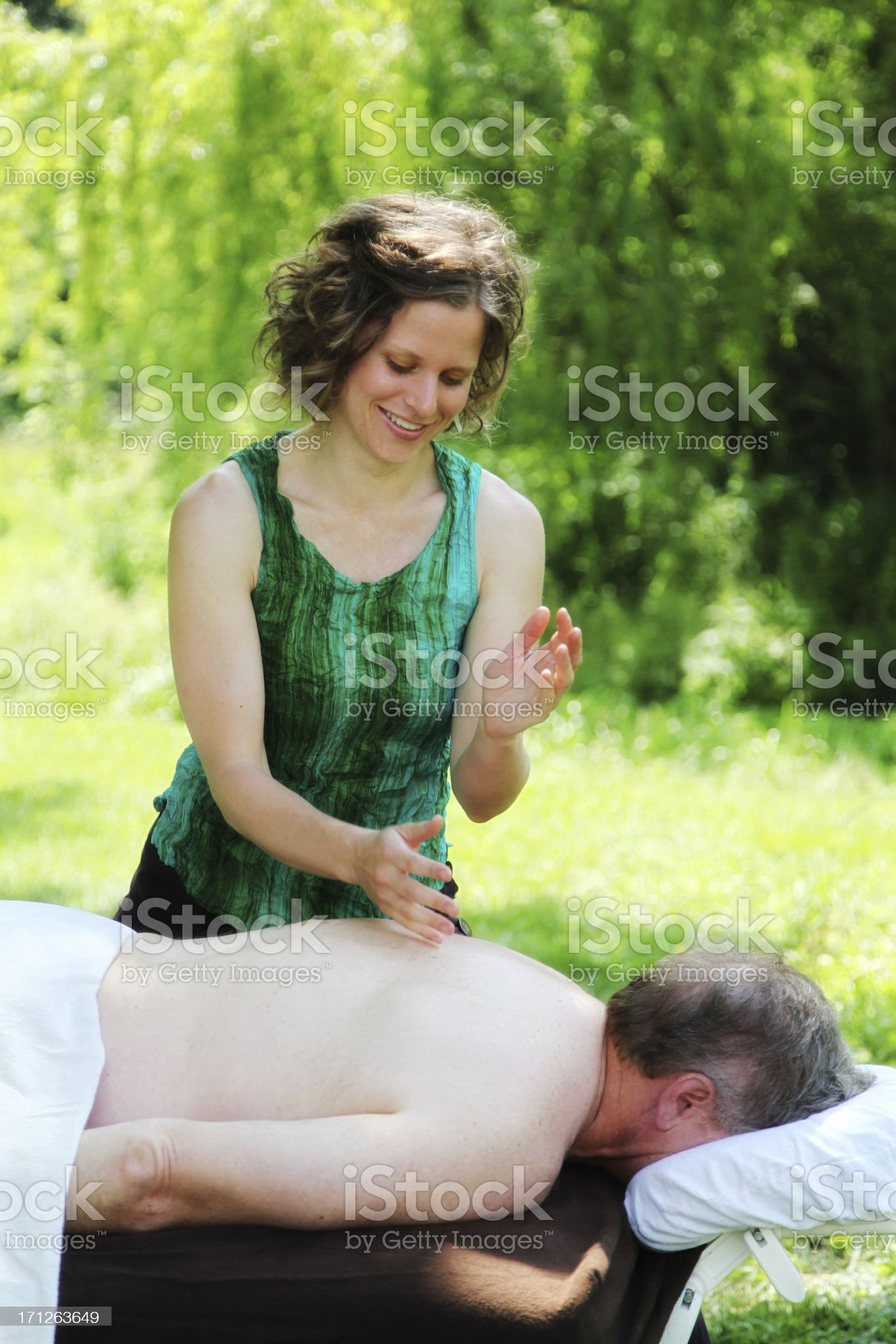 Beautiful Massage Therapist Massages Mature Man Outdoors royalty-free stock photo