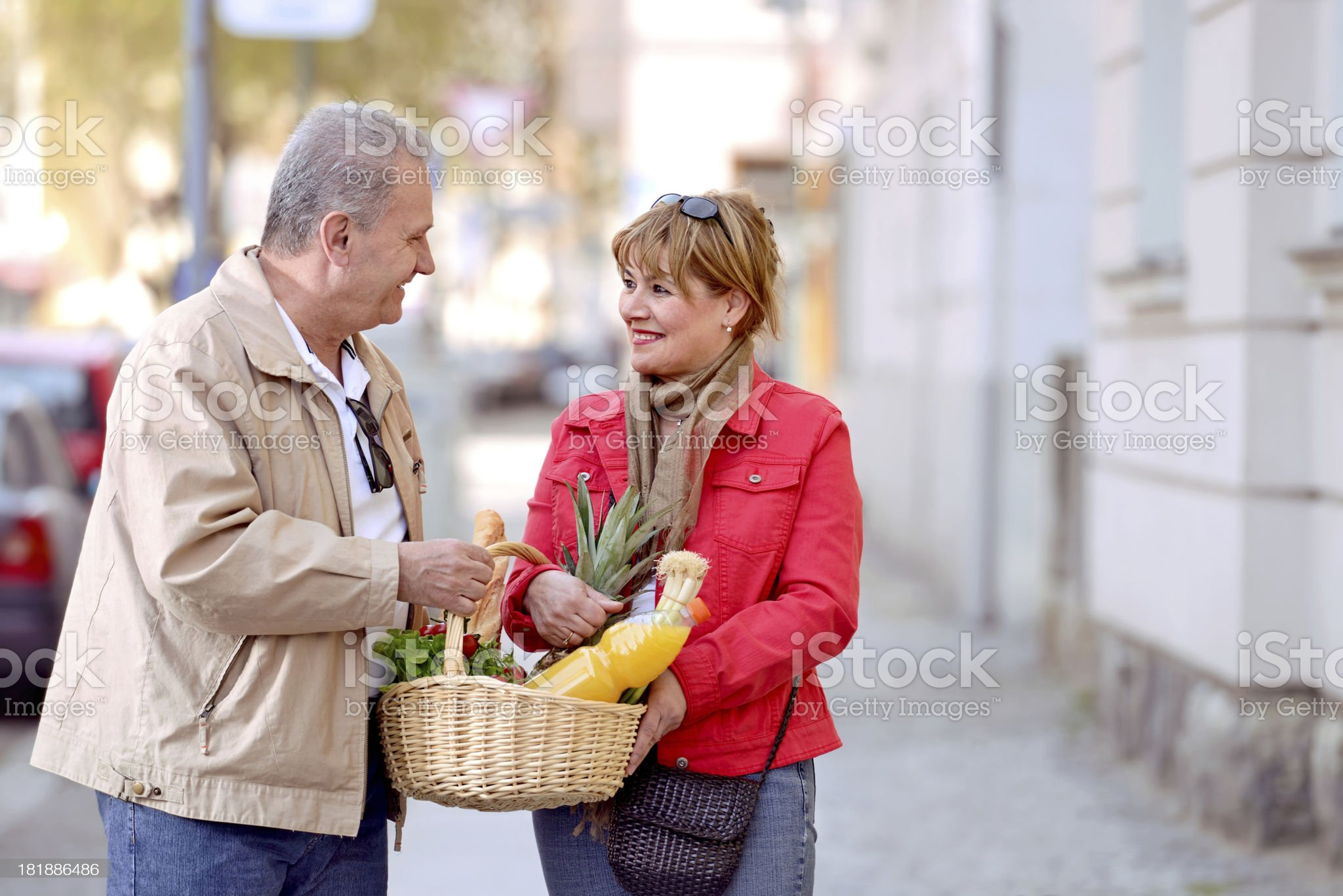 Beautiful mature couple having a small talk on the street royalty-free stock photo