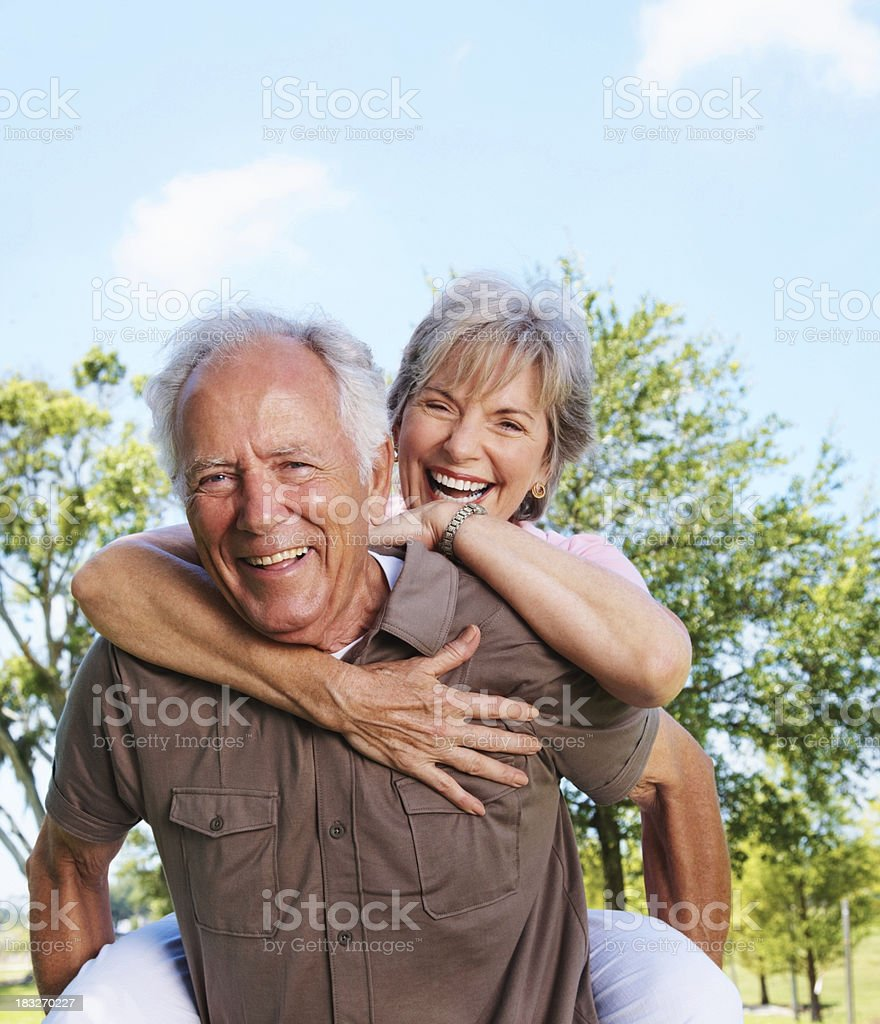 Beautiful mature couple in a playful mood royalty-free stock photo