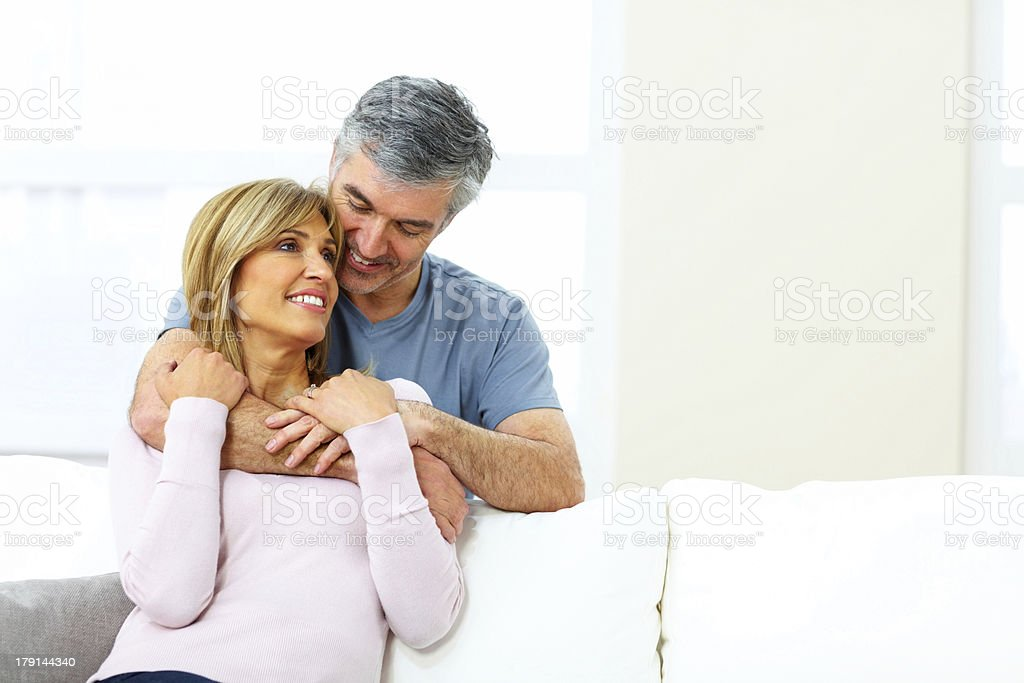 Beautiful mature couple in love sitting together royalty-free stock photo