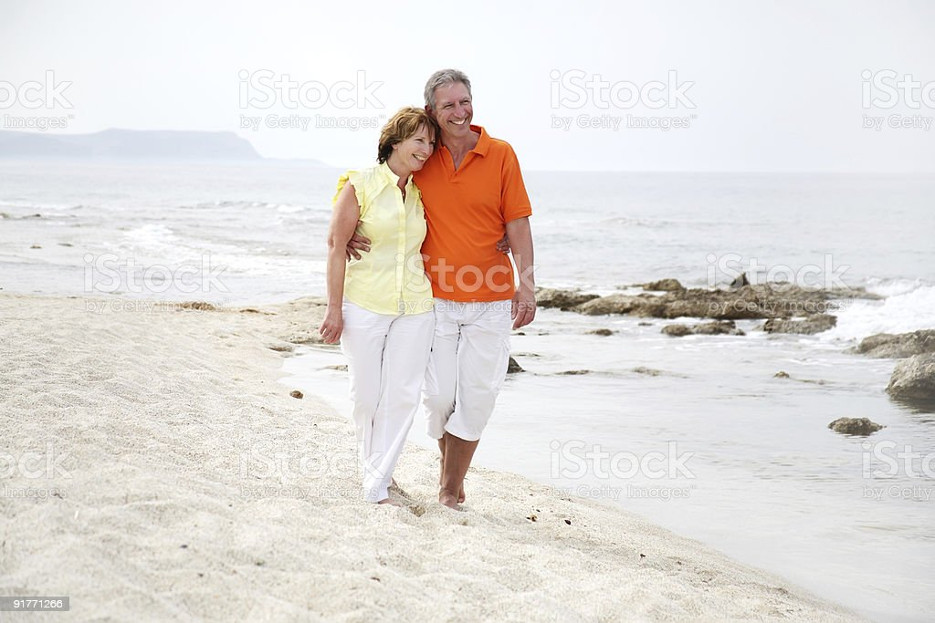 beautiful mature couple on the beach royalty-free stock photo