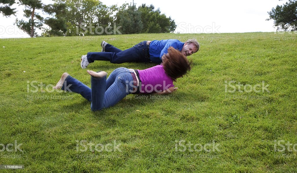 Beautiful Mature Couple Outside Playing and Laughing stock photo
