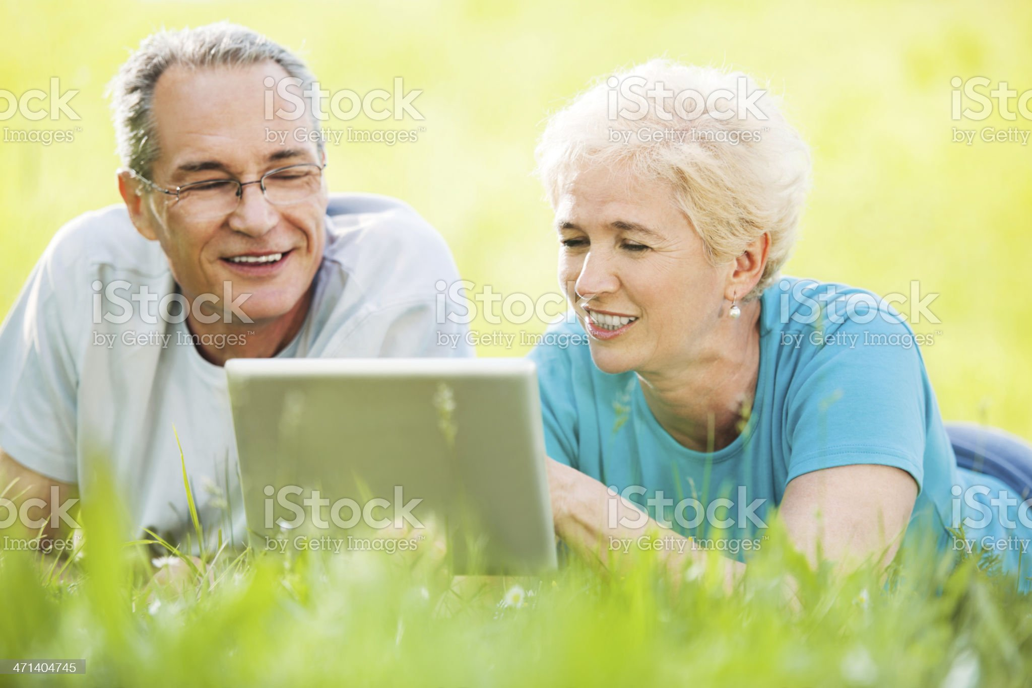 Beautiful mature couple using digital tablet. royalty-free stock photo