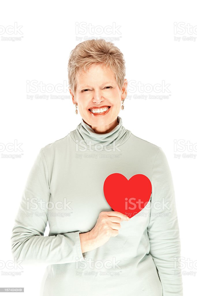 Beautiful mature female holding heart smiling royalty-free stock photo