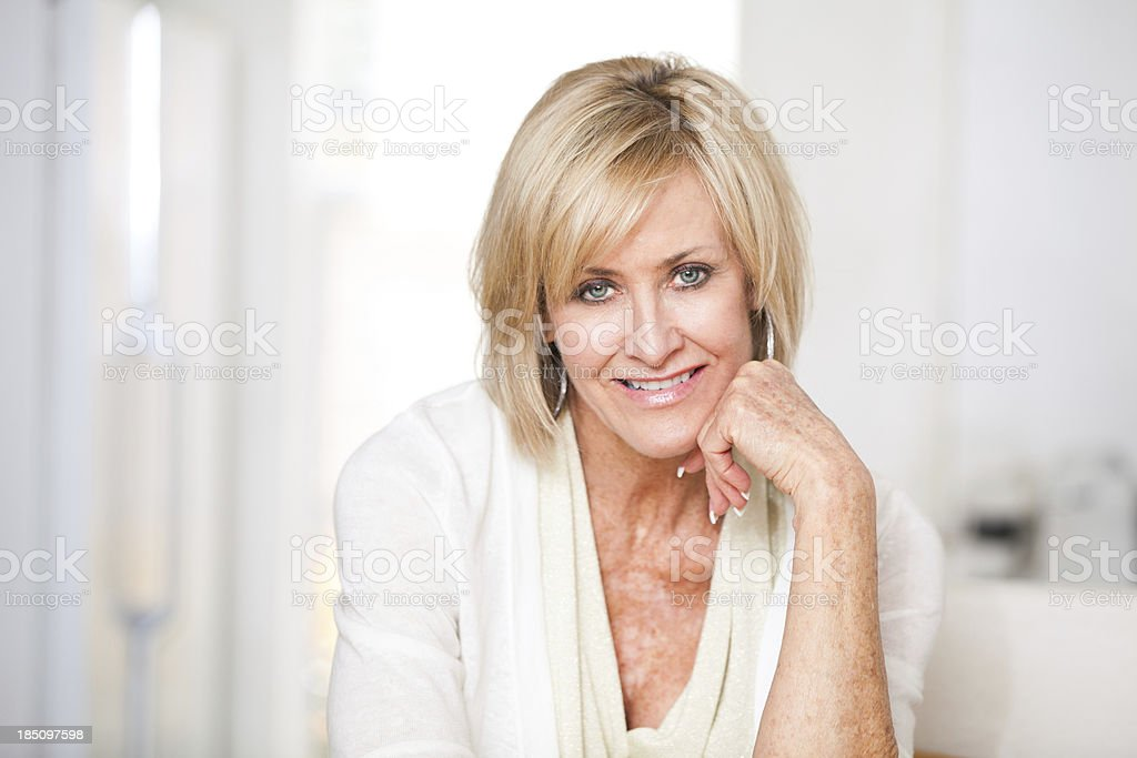Beautiful mature woman in late 50s royalty-free stock photo