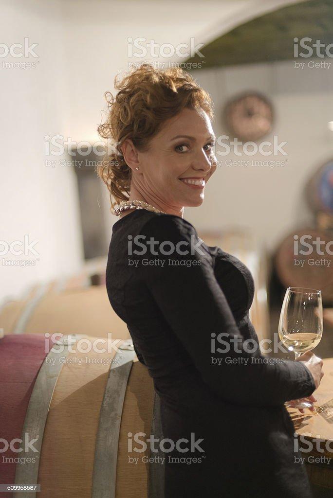 Beautiful Mature Woman in Old Wine Cellar, Europe stock photo
