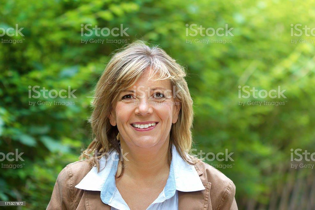 Beautiful Mature woman portrait outdoor stock photo
