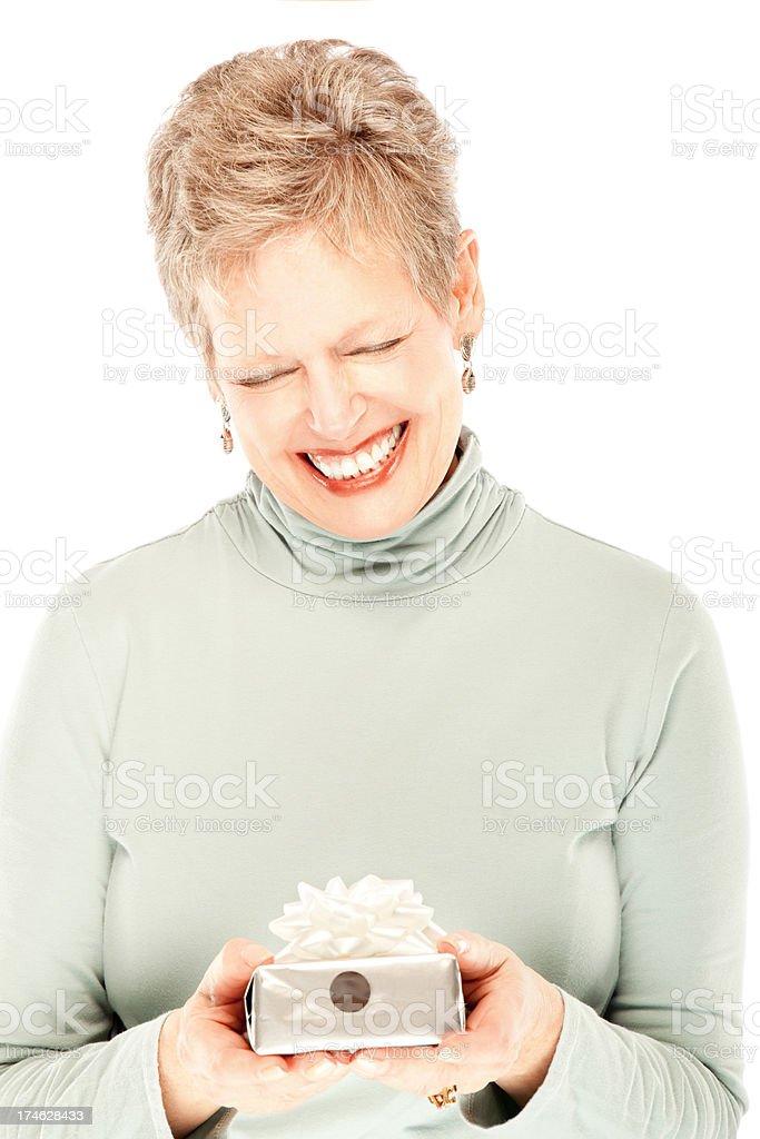 Beautiful mature woman receiving gift royalty-free stock photo