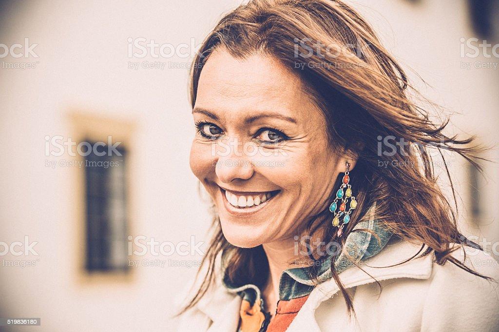 Beautiful mature woman smiling stock photo