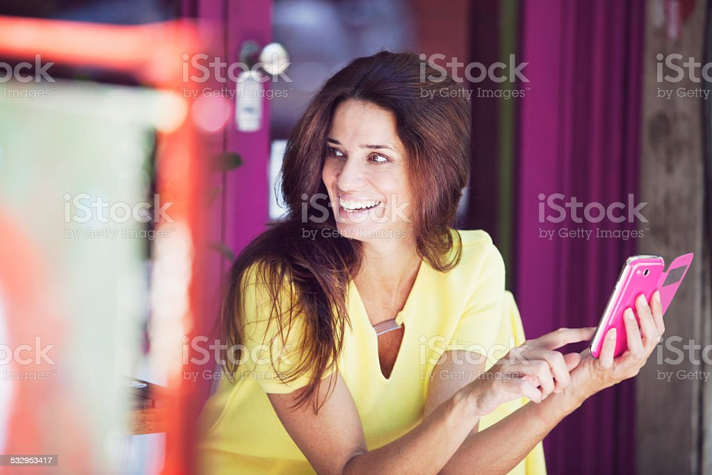 Beautiful Mature Woman Smiling with Cel Phone stock photo