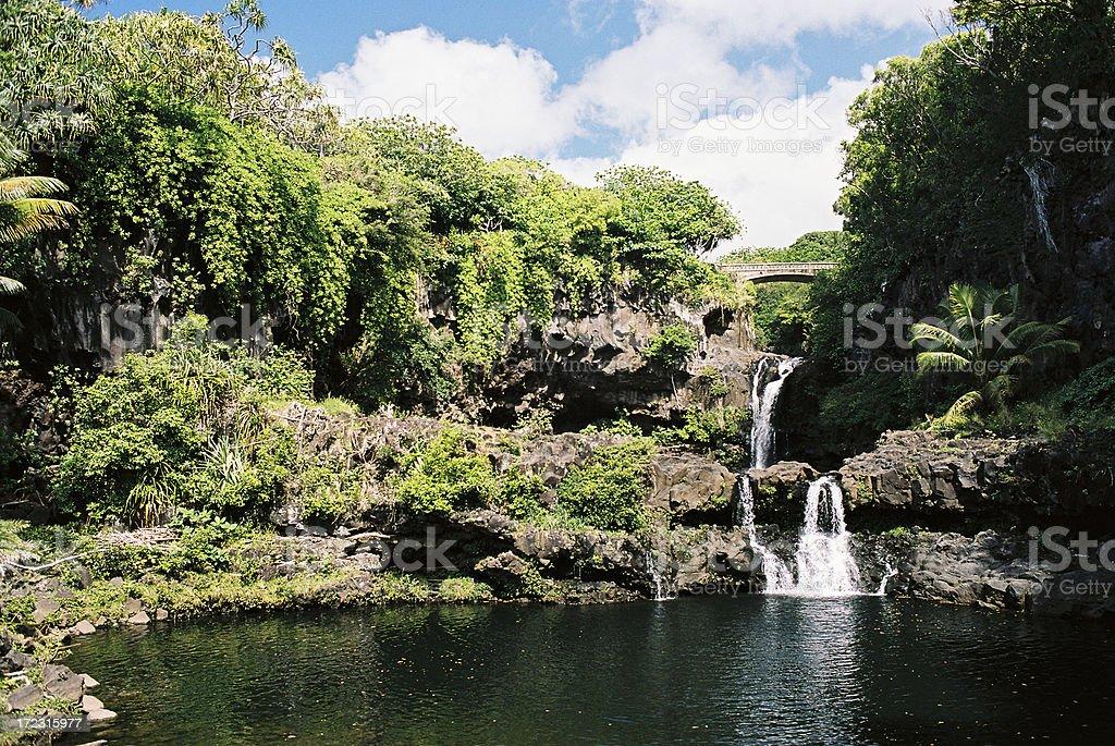 Beautiful Mauai Hawaii waterfall and swimming pond royalty-free stock photo