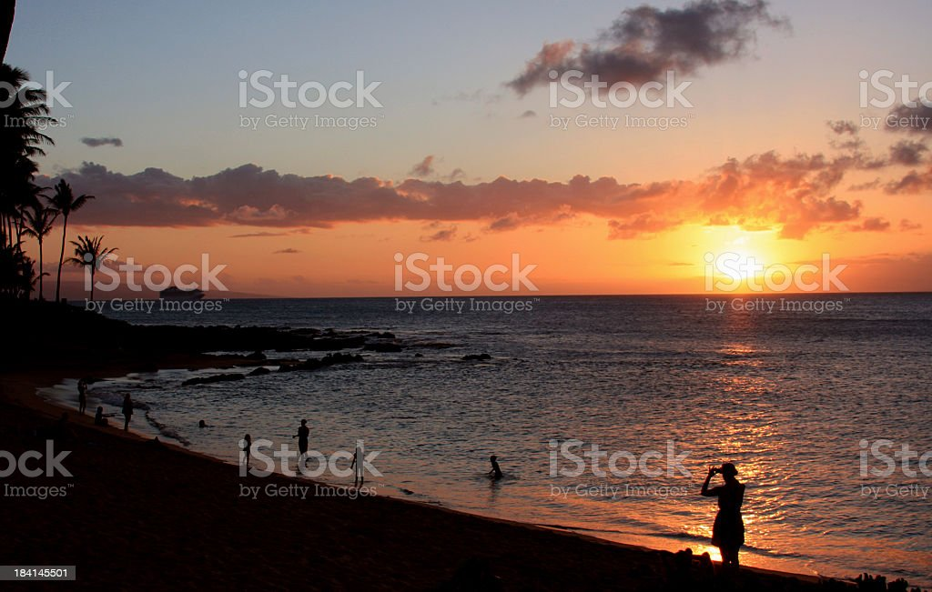 Beautiful Maui Hawaii  Pacific ocean beach sunset silhouette scenic stock photo