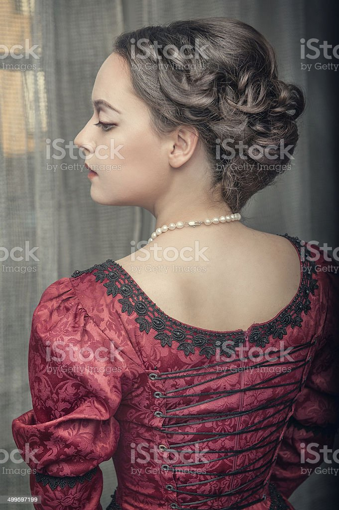 Beautiful medieval woman in red dress stock photo