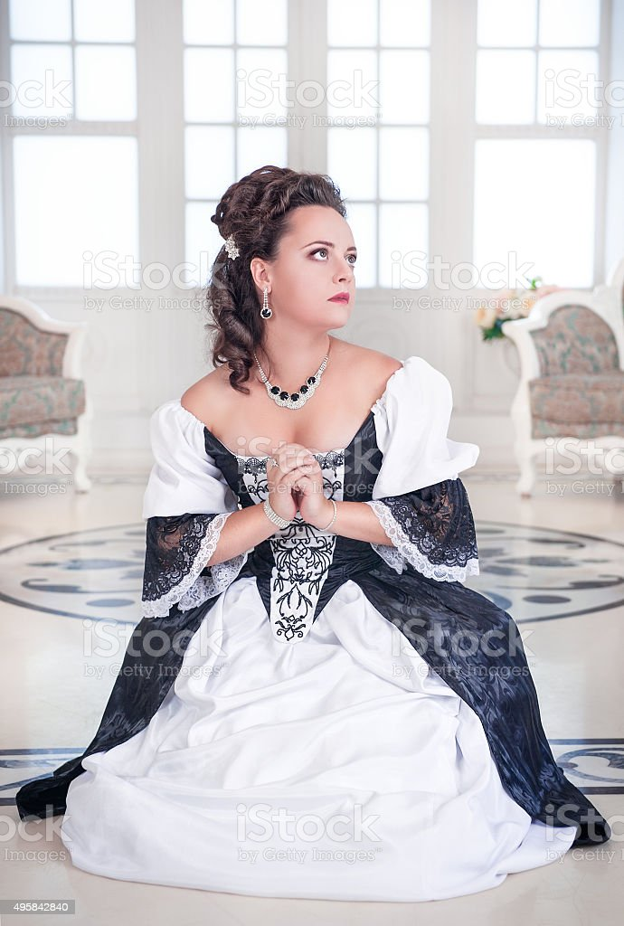 Beautiful medieval woman praying stock photo