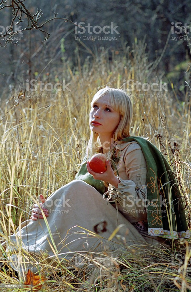 beautiful medieval woman sitting on forest glade royalty-free stock photo