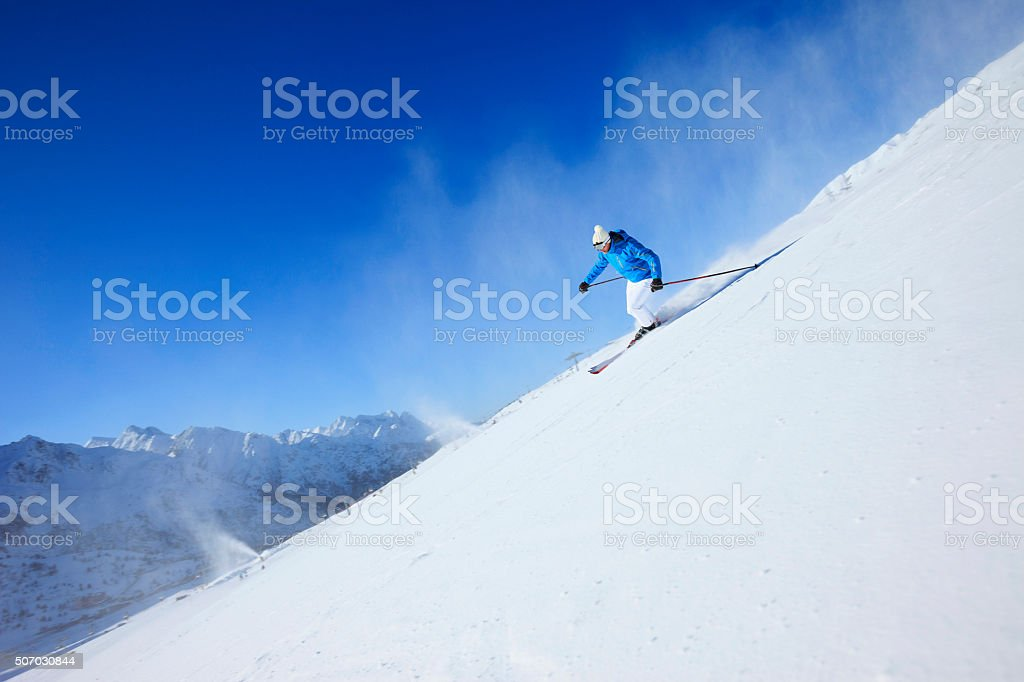 Beautiful Men snow skier skiing on sunny ski resorts stock photo