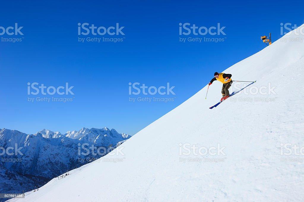 Beautiful Men snow skier skiing on sunny ski resorts stock photo