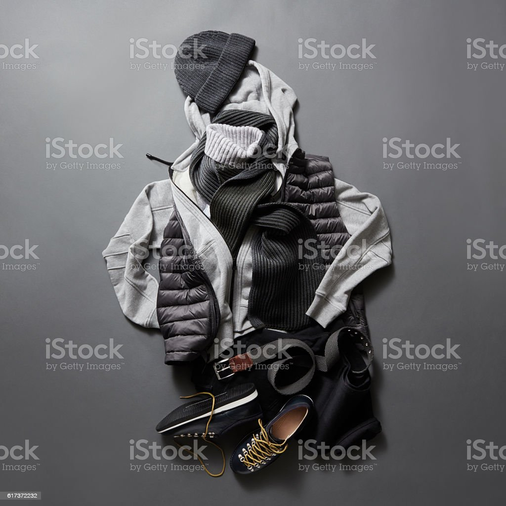 Beautiful men's clothes and accessories on a black background. stock photo