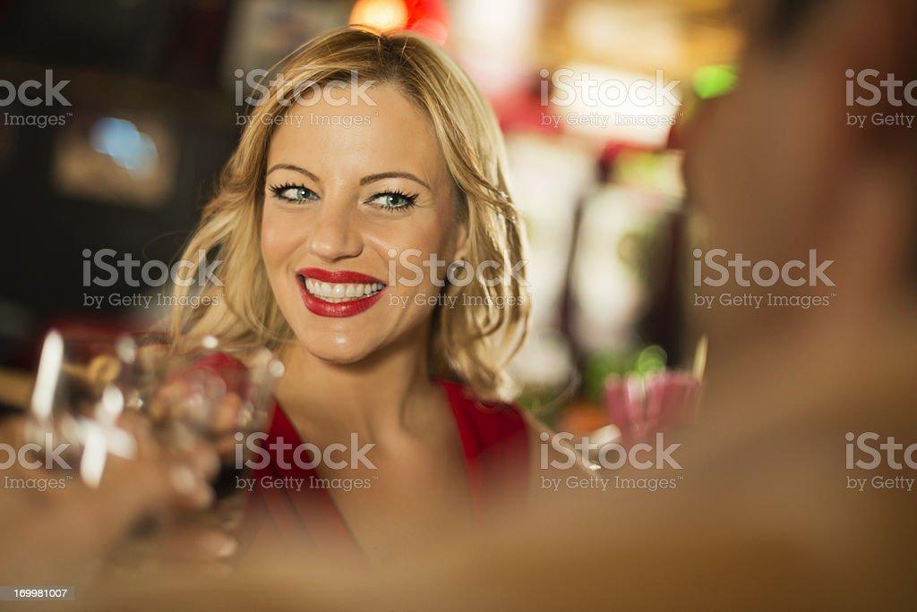 Beautiful mid adult woman enjoying in a pub. royalty-free stock photo