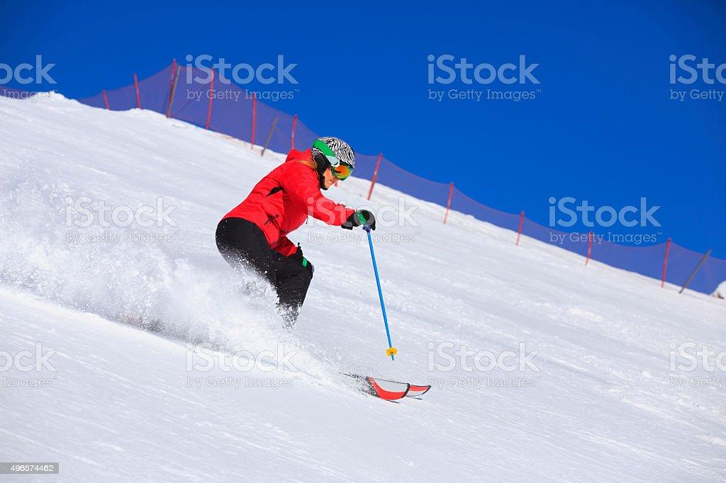 Beautiful mid adult women snow skier skiing  Sunny ski resorts stock photo