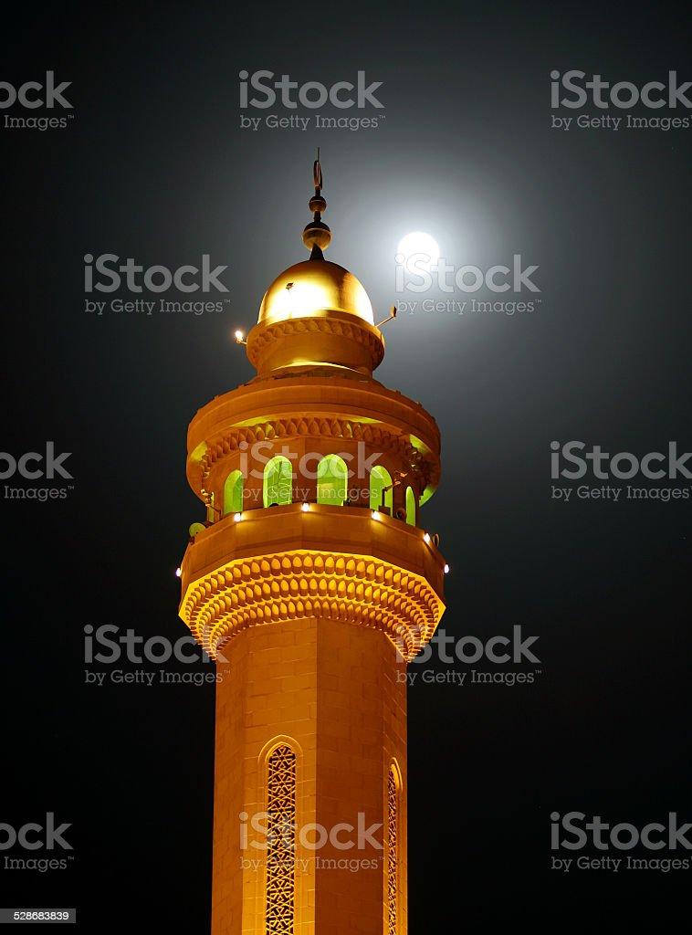 Beautiful minaret of Al Fateh Mosque & super moon stock photo