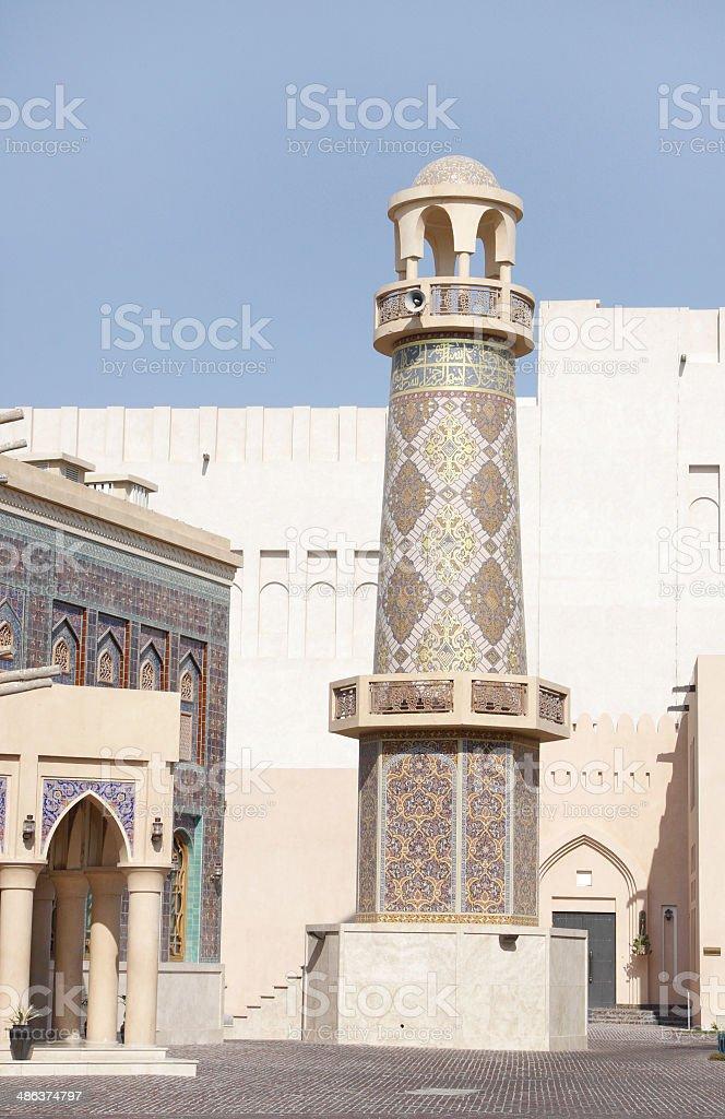 Beautiful minaret of ornamented mosque in Katara village, Qatar stock photo