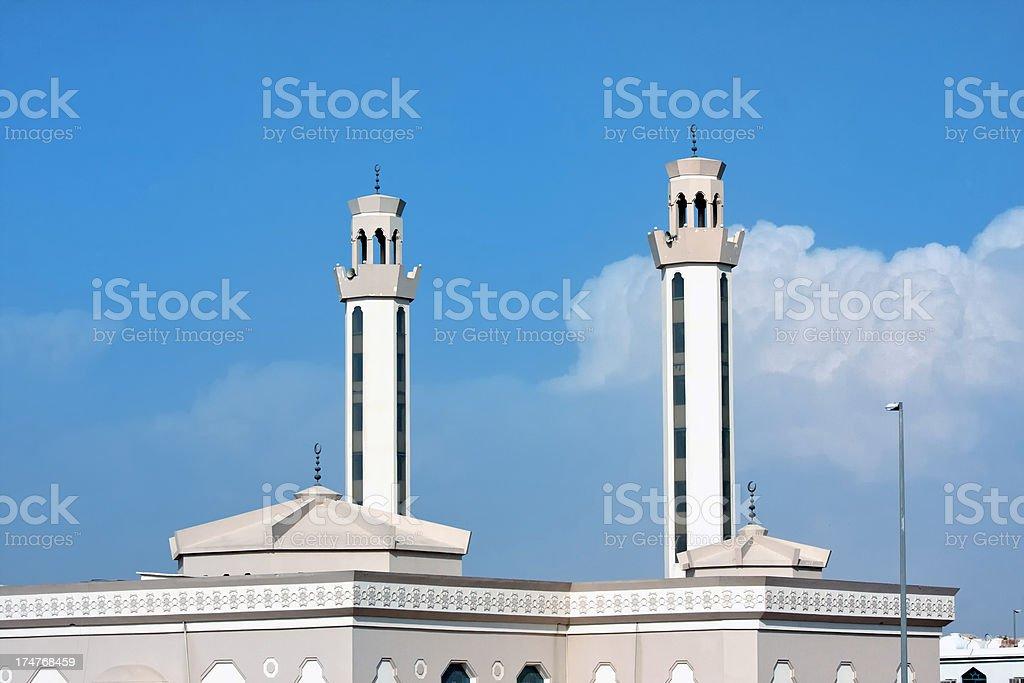 beautiful minaret on blue sky stock photo