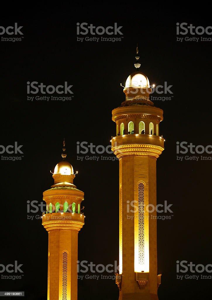 Beautiful minarets of Al Fateh Mosque illuminated at night, Bahrain stock photo