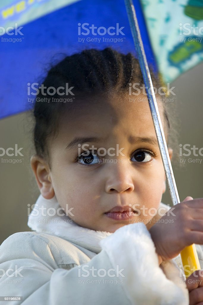 Beautiful Mixed Race African American Girl Under an Umbrella stock photo