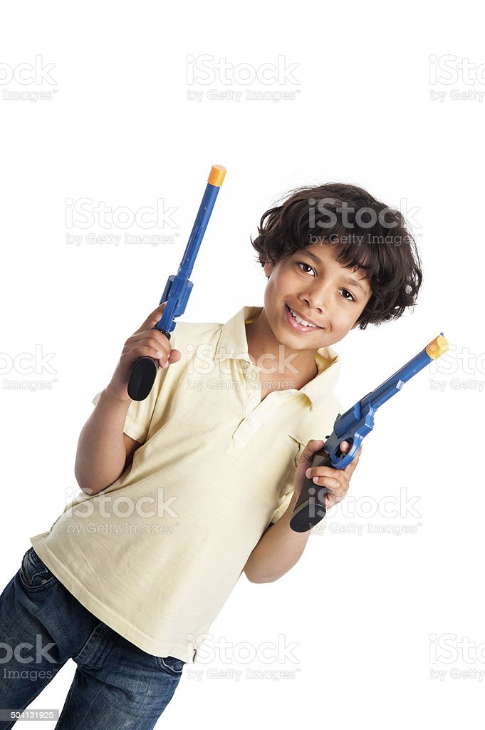 Beautiful Mixed Race Boy Playing with Toy Guns stock photo