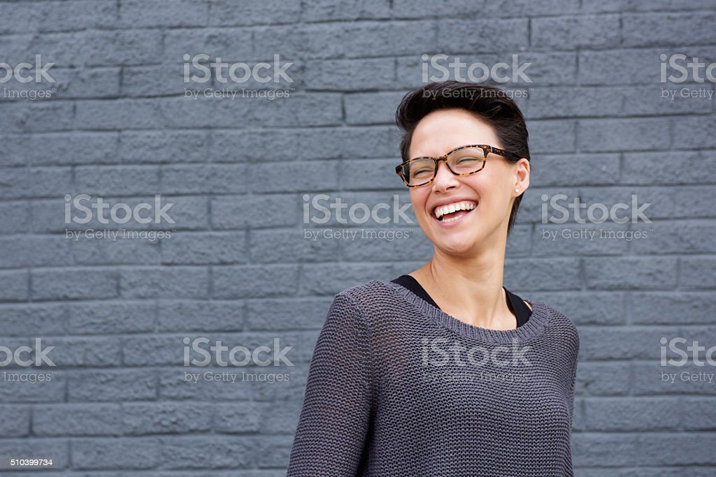 Beautiful mixed race woman laughing with glasses stock photo
