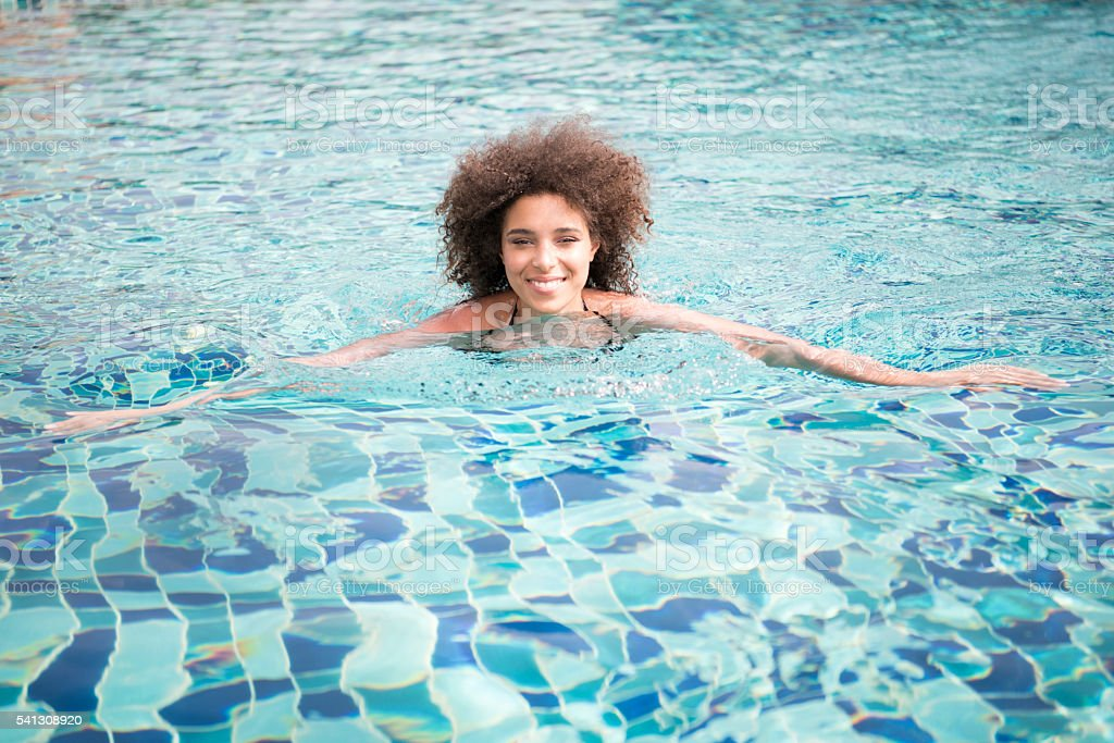 Beautiful Mixed Race Woman on Vacation in the Pool stock photo
