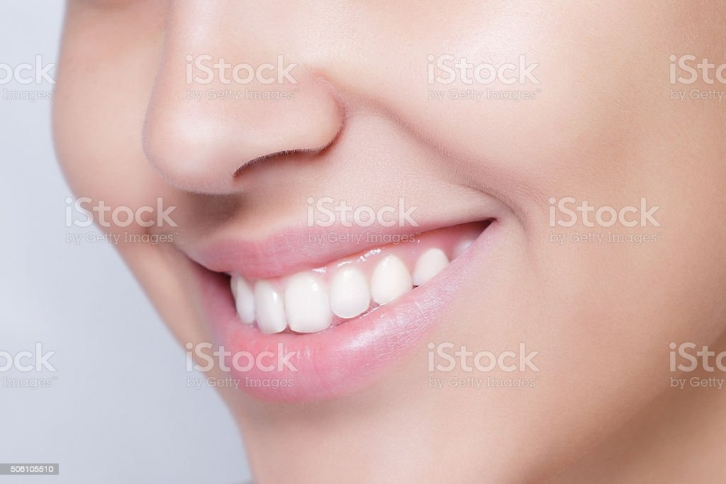 beautiful model applying cosmetic cream treatment on her face white stock photo