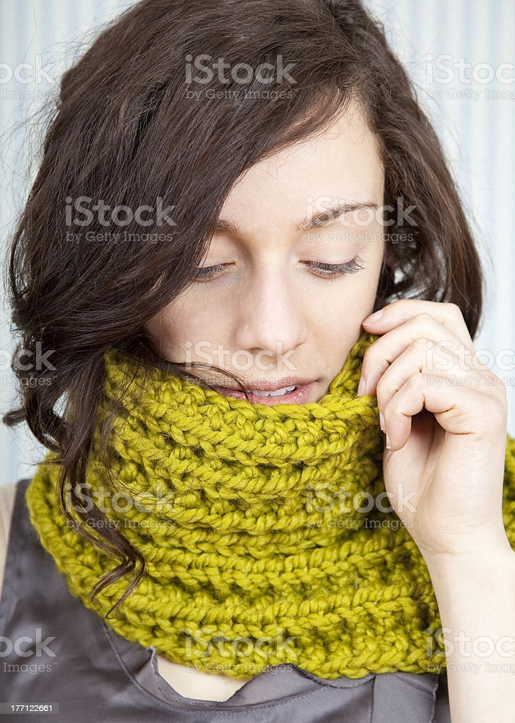 Beautiful model in a lime green knit scarf stock photo