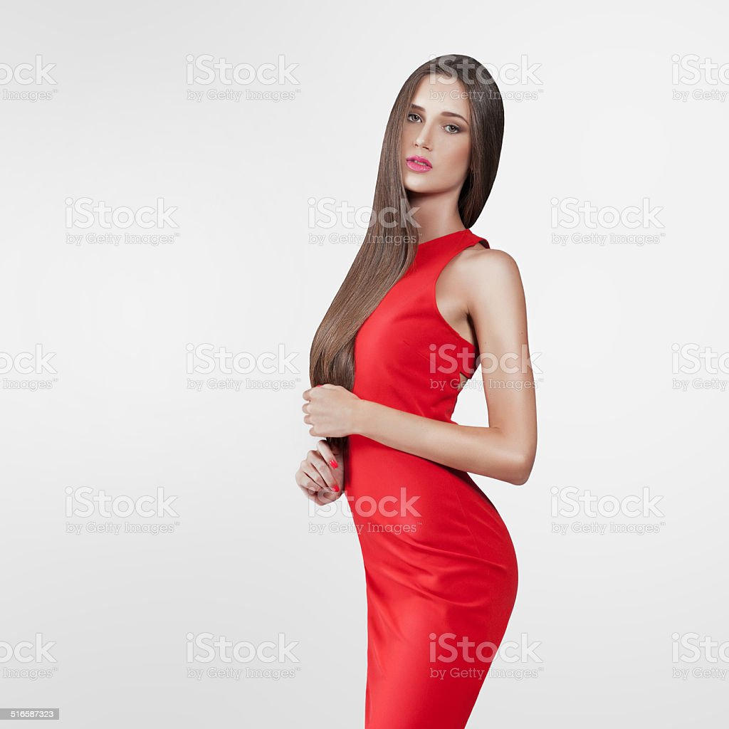 beautiful model in red dress stock photo