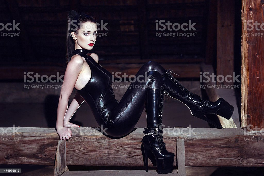 Beautiful model posing on timber in platform boots royalty-free stock photo