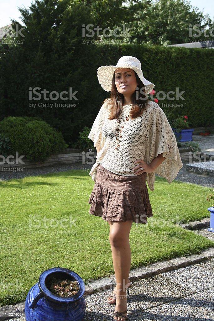 Beautiful model standing in garden royalty-free stock photo