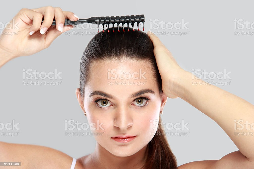 beautiful model tidy up her hair stock photo