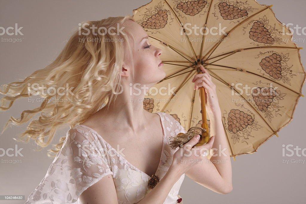 Beautiful model wearing a wedding dress, studio royalty-free stock photo