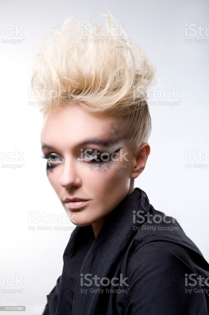 Beautiful Blond Young Woman Fashion Model, Professional Hairstyle and Makeup stock photo